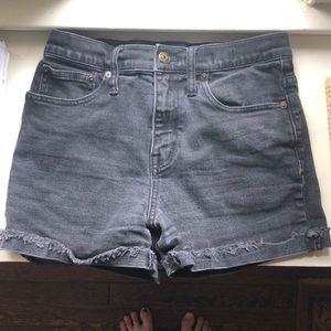 Madewell, black high-rise denim shorts.